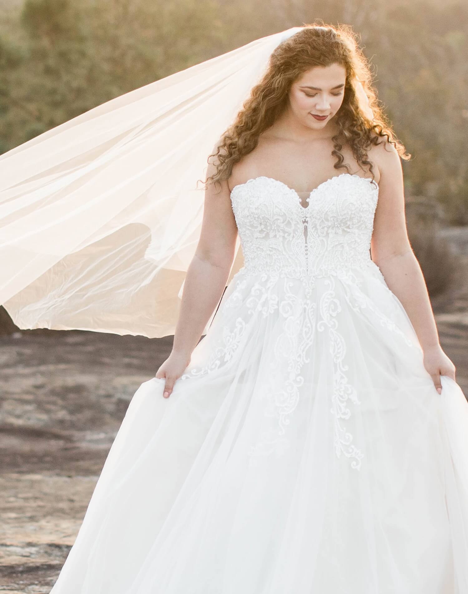 Plus size bride in white gown